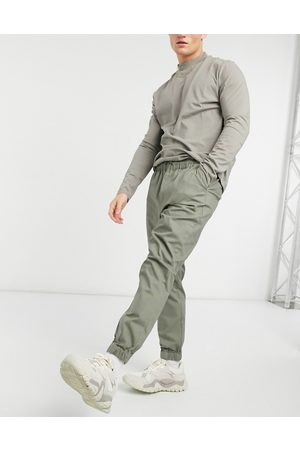 ASOS Tapered chino joggers with elasticated waist in khaki-Green
