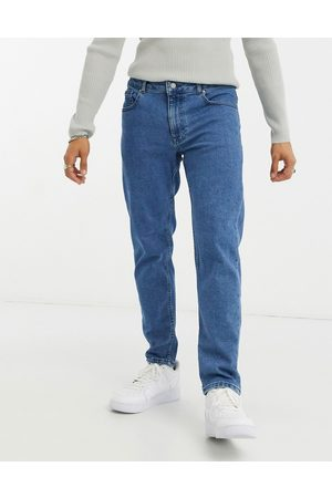 ASOS Muži Strečové - Stretch tapered jeans in retro mid wash blue
