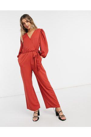 Monki Tia wrap front jumpsuit in rust-Red