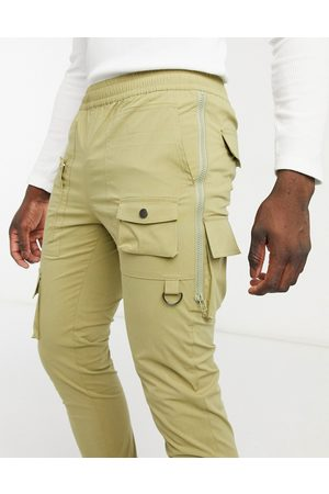 ASOS Skinny trousers with side zips in light khaki-Green