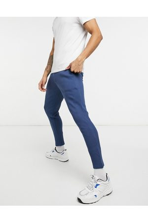 ASOS Muži Tepláky - Smart co-ord super skinny joggers in waffle with fixed hem-Blue