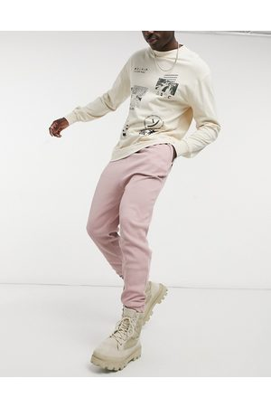 ASOS Drop crotch joggers in dusty pink waffle