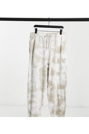 COLLUSION Tepláky - Unisex oversized joggers in tie dye-Multi