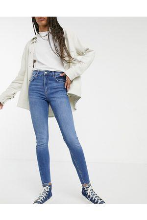 Bershka High rise skinny jean in blue