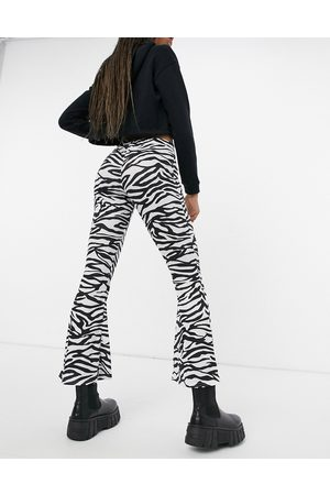 Another Reason High waisted flare trousers in monogram zebra-Multi