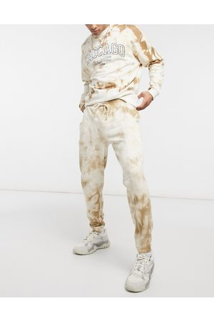 ASOS Co-ord oversized joggers in tie dye with stitch detail-Tan