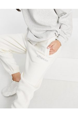Ellesse Joggers with diamante logo in off white- exclusive to ASOS