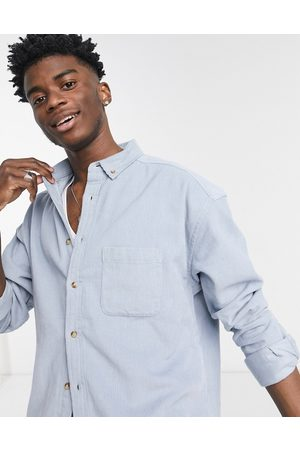ASOS 90's oversized cord shirt in dusty blue