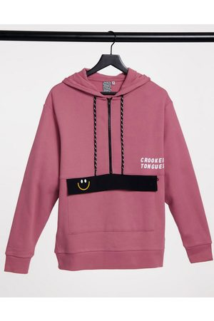 Crooked Tongues Hoodie with large pocket in pink
