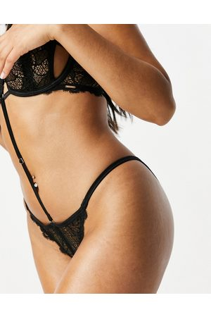 BlueBella Mera lace removeable harness detail thong with floral crochet trim in black