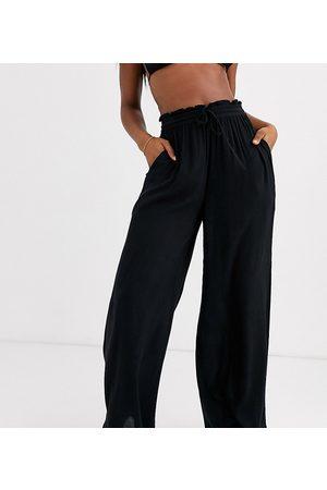 Iisla & Bird Exclusive drawstring beach trouser in black