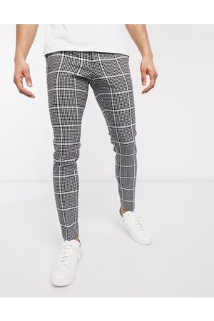 ASOS Smart super skinny trousers in black wool mix check