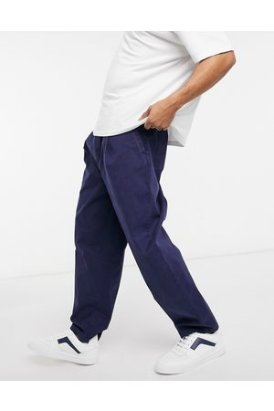 ASOS Muži Chino - Wide leg trousers with pleats in washed navy