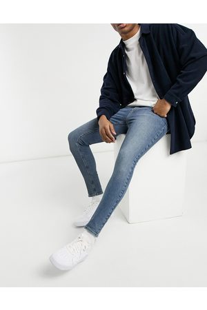 ASOS Vintage look spray on jeans with power stretch in mid blue