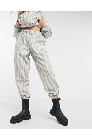 Crooked Tongues Co-ord oversized jogger in animal print with logo-Multi