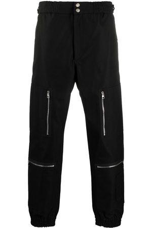 Alexander McQueen Multi-pocket cuffed trousers
