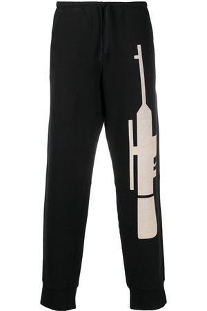 WALTER VAN BEIRENDONCK Gun print track pants