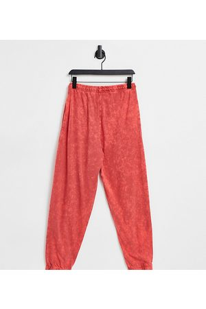 COLLUSION Unisex oversized joggers in red stone wash co-ord