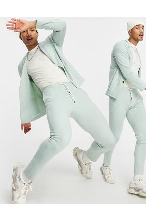 ASOS Super skinny soft tailored suit trousers in mint green jersey
