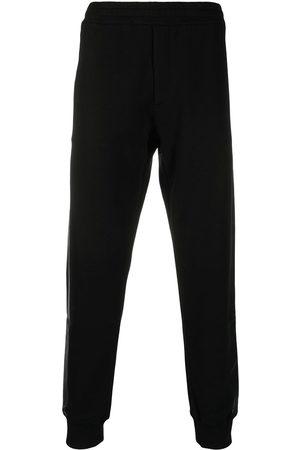 Alexander McQueen Muži Tepláky - Side-stripe track pants