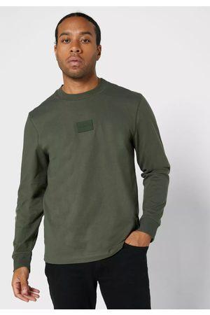 Calvin Klein Muži S dlouhým rukávem - Pánské zelené triko s dlouhým rukávem
