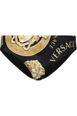 VERSACE Printed logo swim trunks