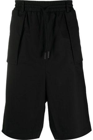 MARCELO BURLON Knee-length track shorts