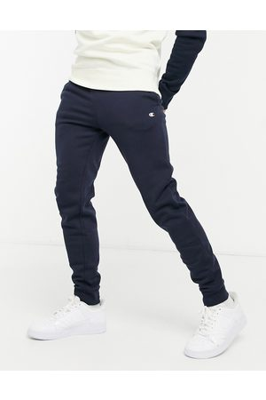 Champion Small logo cuffed joggers in navy
