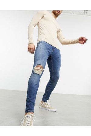 ASOS Spray on jeans with power stretch in vintage dark wash with rips-Blue