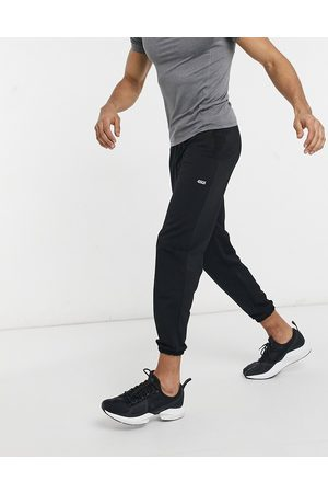 ASOS Icon training joggers with tapered fit in black