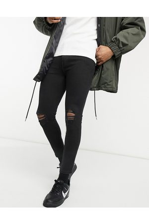 Pull&Bear Super skinny jeans with rips in black