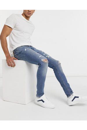 Jack & Jones Muži Skinny - Intelligence Liam skinny jeans with rips in blue