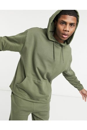 ASOS Organic tracksuit with oversized hoodie & oversized joggers in khaki-Green
