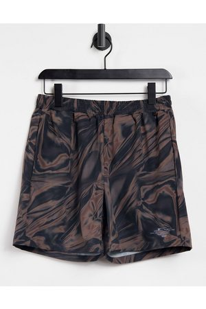 ASOS Training shorts with all over print-Brown