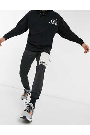 ASOS Joggers in black nylon with cut and sew panelling
