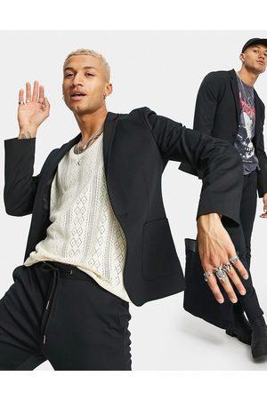 ASOS Super skinny suit jacket in black jersey