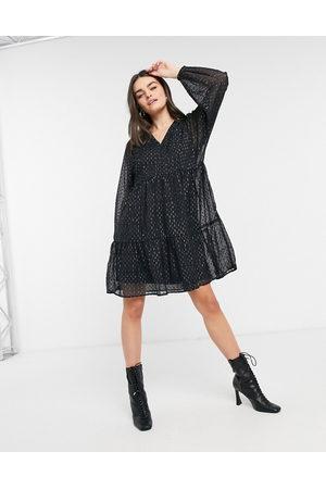 Vero Moda Mini smock dress with puff sleeves in black spot print-Silver