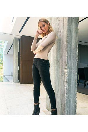 Stradivarius Petite skinny jeans in black