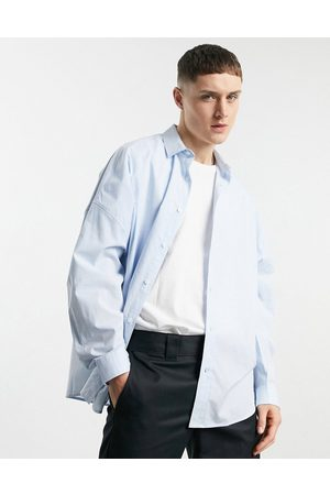 ASOS Dropped shoulder oversized shirt in graph check in blue