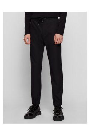 HUGO BOSS Muži Kalhoty - Kalhoty z materiálu