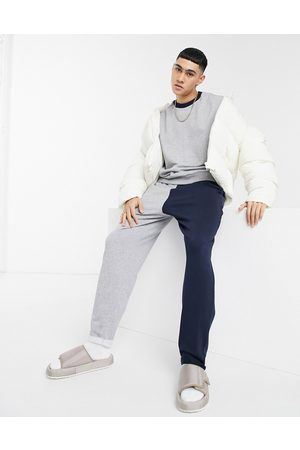 ASOS Co-ord oversized joggers in grey marl & navy colour block & rolled hem