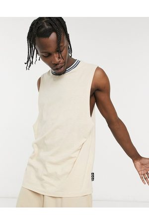 ASOS Relaxed vest in beige with tipping and branded patch