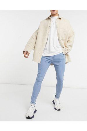 Bershka Super skinny fit jeans in mid blue