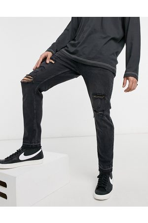 Bershka Skinny fit jeans with rips in washed black