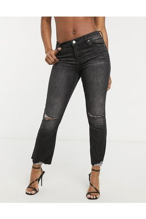 BLANK NYC Distressed knee kick flare jeans in washed black