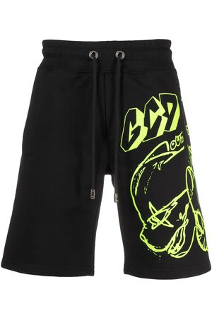 GCDS Graffiti print track shorts