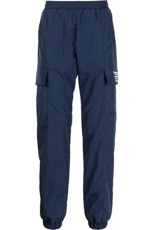 MISBHV Tecn embroidery track pants