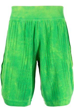 GCDS Pleated knee-length shorts