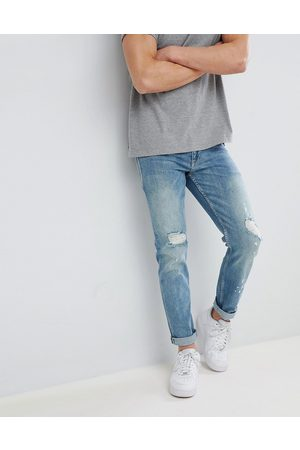 ASOS Stretch slim jeans in mid wash blue with rips
