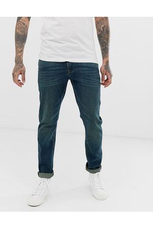 ASOS Muži Slim - Stretch slim jeans in vintage dark wash blue